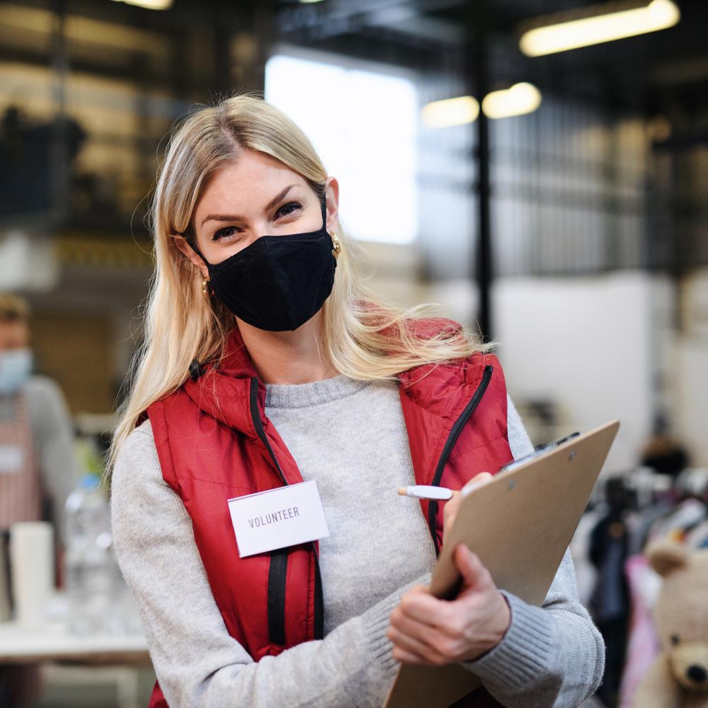volunteer in red jacket improving her health and wellbeing